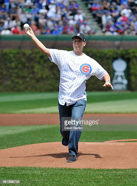 Northwestern mens basketball coach Chris Collins throw out the first pitch before the game between the Chicago Cubs and the Milwaukee Brewers on May...