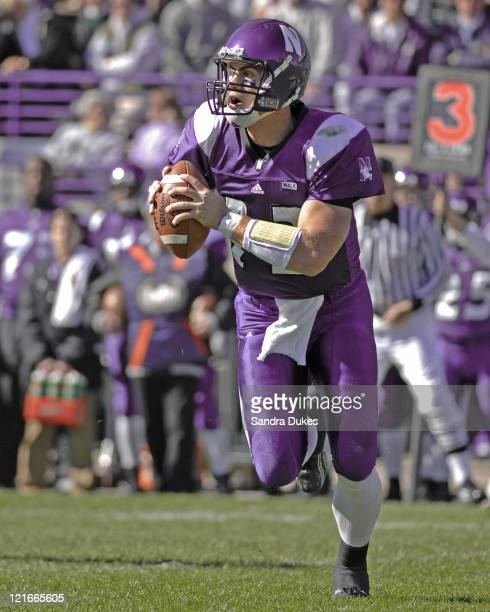 Northwestern QB Andrew Brewer rolls out and looks for a receiver in a game won by Purdue over Northwestern 31-10 at Ryan Field in West Lafayette,...
