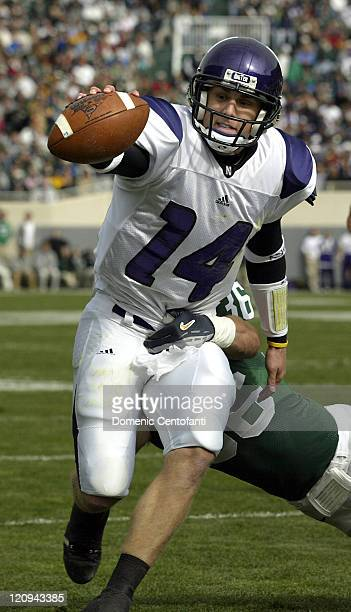 Northwestern quarterback Brett Basanez reaches for the goal line as he crosses for a 5yard touchdown in the first quarter versus Michigan State at...