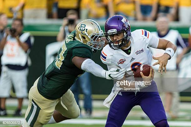 Northwestern State Demons quarterback Brooks Haack tries to escape from Baylor Bears defensive end Jamie Jacobs during the game between the Baylor...
