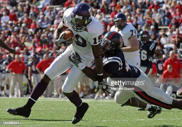 Northwestern State wide receiver Dudley Guice eludes Ole Miss linebacker Rory Johnson on his way to the endzone at Vaught-Hemingway Stadium in...