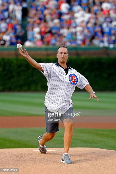 Northwestern University men's basketball head coach Chris Collins throws a ceremonial first pitch before the game between the Chicago Cubs and the St...
