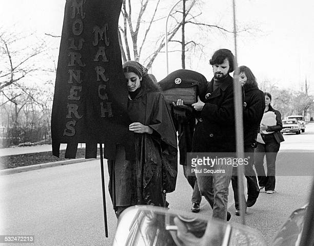 Northwestern University students march in protest of the Kent State University killings Chicago Illinois 1970 They carry a coffin and a banner that...