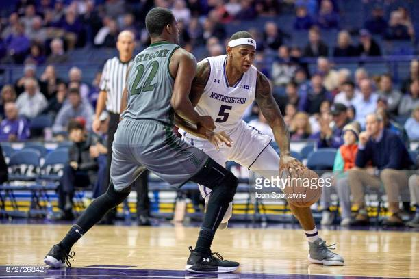 Northwestern Wildcats center Dererk Pardon battles with Loyola Greyhounds forward Brent Holcombe in the second half during a college basketball game...