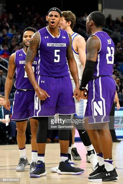 Northwestern Wildcats center Dererk Pardon reacts after blocking the shot of DePaul Blue Demons guard Eli Cain during the game between the DePaul...