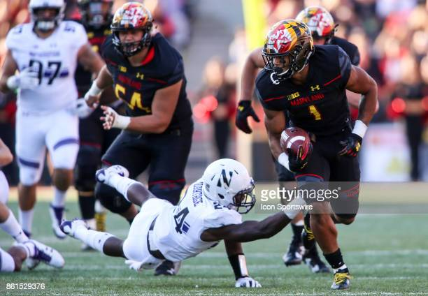 Northwestern Wildcats cornerback Montre Hartage can't hold on to Maryland Terrapins wide receiver DJ Moore during a college football game between the...