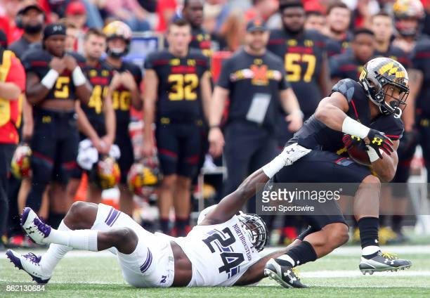 Northwestern Wildcats cornerback Montre Hartage grabs at Maryland Terrapins wide receiver DJ Moore during a college football game between the...