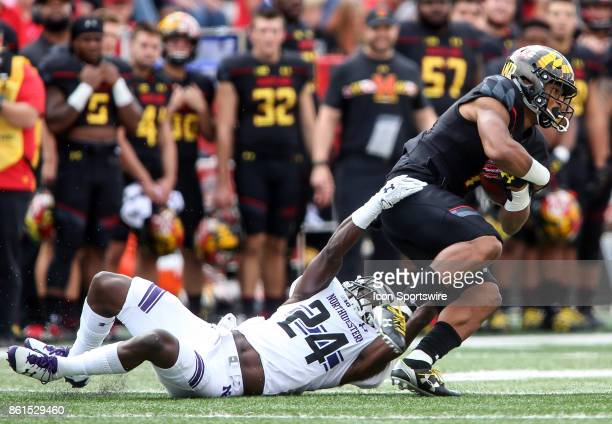 Northwestern Wildcats cornerback Montre Hartage hangs onto Maryland Terrapins wide receiver DJ Moore during a college football game between the...