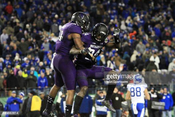 Northwestern Wildcats defenders Montre Hartage and Parker Westphal celebrate stopping the Kentucky Wildcats 2point conversion attempt in the final...