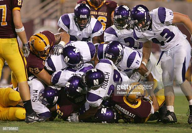 Northwestern Wildcats defense gang tackles against the Arizona State Sun Devils at Sun Devil Stadium on September 17 2005 in Tempe Arizona The Sun...