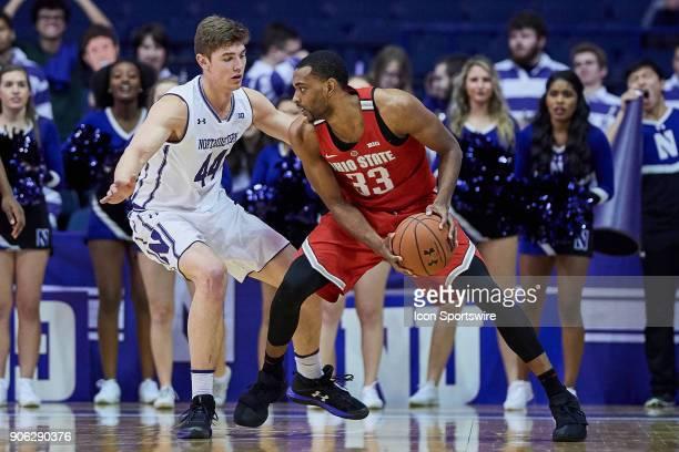 Northwestern Wildcats forward Gavin Skelly battles with Ohio State Buckeyes forward Keita BatesDiop during the BIG Ten college basketball game...