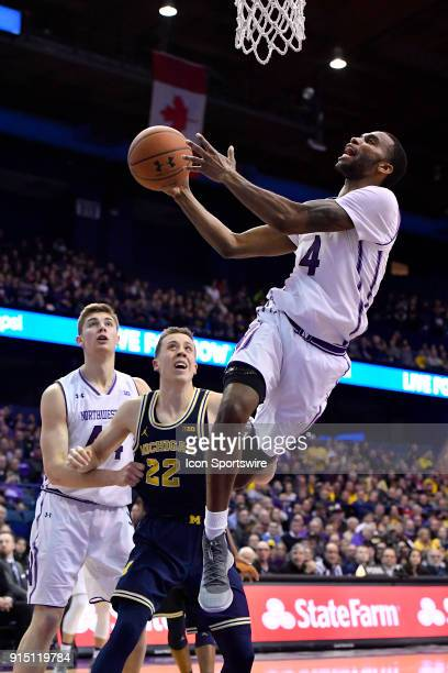 Northwestern Wildcats forward Vic Law shoots a layup in front of Michigan Wolverines guard Duncan Robinson during the game between the Northwestern...