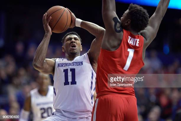 Northwestern Wildcats guard Anthony Gaines battles with Ohio State Buckeyes forward Jae'Sean Tate during the BIG Ten college basketball game between...