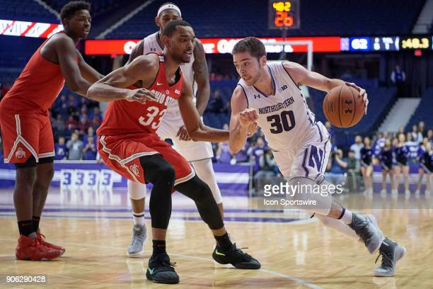 Northwestern Wildcats guard Bryant McIntosh battles with Ohio State Buckeyes forward Keita BatesDiop during the BIG Ten college basketball game...
