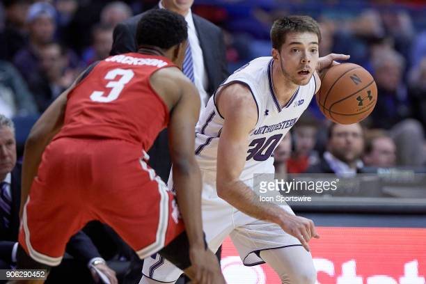 Northwestern Wildcats guard Bryant McIntosh battles with Ohio State Buckeyes guard CJ Jackson during the BIG Ten college basketball game between the...