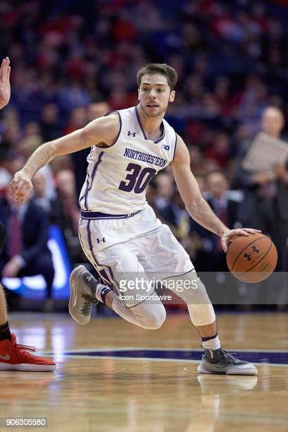 Northwestern Wildcats guard Bryant McIntosh dribbles the basketball during the BIG Ten college basketball game between the Northwestern Wildcats and...