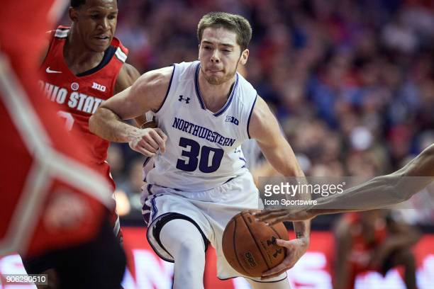 Northwestern Wildcats guard Bryant McIntosh nadles the basketball in traffic during the Big Ten college basketball game between the Northwestern...