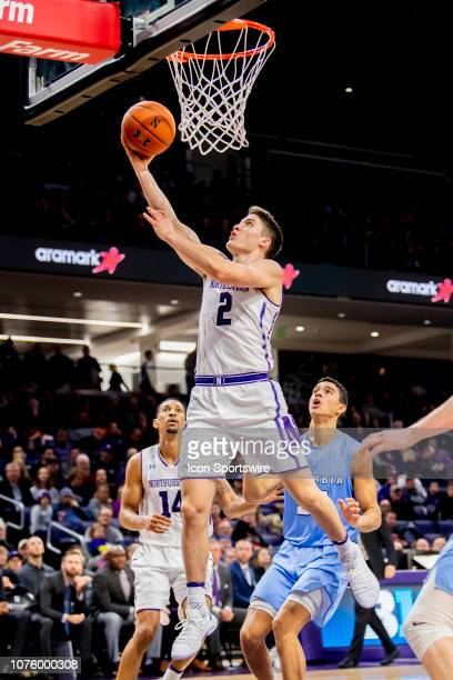 Northwestern Wildcats guard Ryan Greer goes up for a shot during a game between the Columbia Lions and the Northwestern Wildcats on December 30 at...