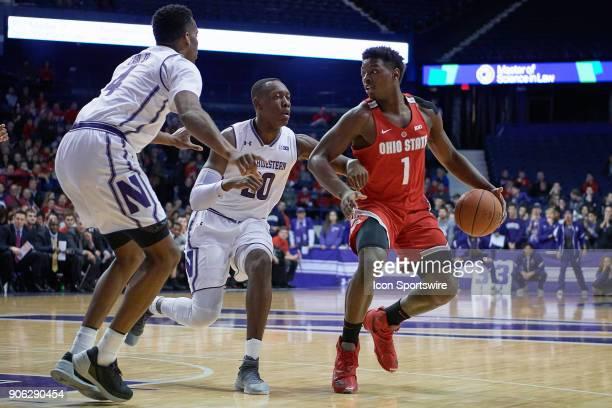 Northwestern Wildcats guard Scottie Lindsey battles with Ohio State Buckeyes forward Jae'Sean Tate during the BIG Ten college basketball game between...
