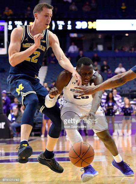 Northwestern Wildcats guard Scottie Lindsey is hit in the face by Michigan Wolverines guard Duncan Robinson as he drives with the basketball during...