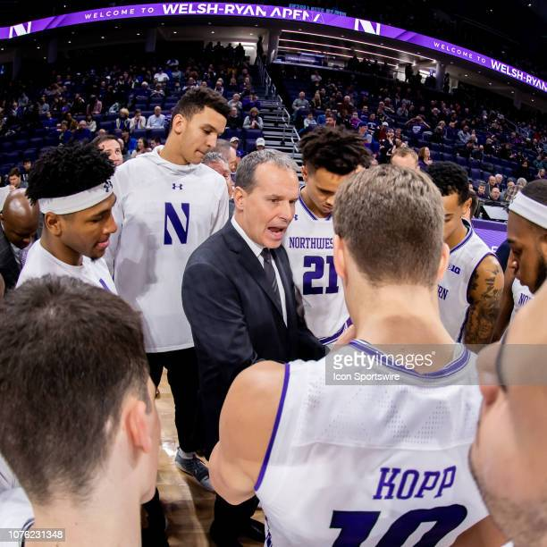 Northwestern Wildcats head coach Chris Collins huddles with his team prior to a game between the Columbia Lions and the Northwestern Wildcats on...