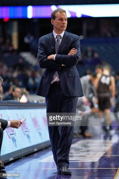 Northwestern Wildcats head coach Chris Collins looks on during a college basketball game between the Northwestern Wildcats and the Brown Bears on...