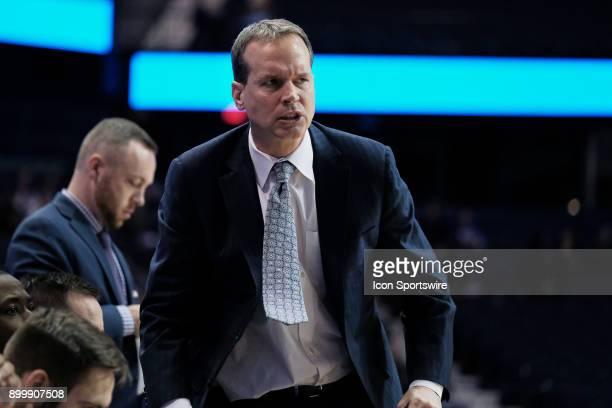 Northwestern Wildcats head coach Chris Collins reacts to a play during a college basketball game between the Northwestern Wildcats and the Brown...