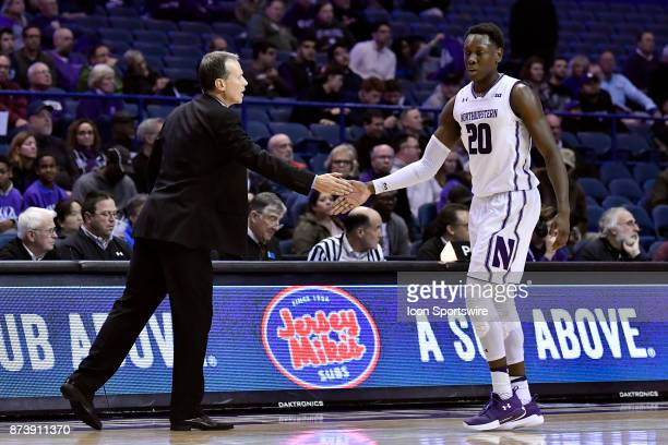 Northwestern Wildcats head coach Chris Collins shakes hands with Northwestern Wildcats guard Scottie Lindsey during a college basketball game between...