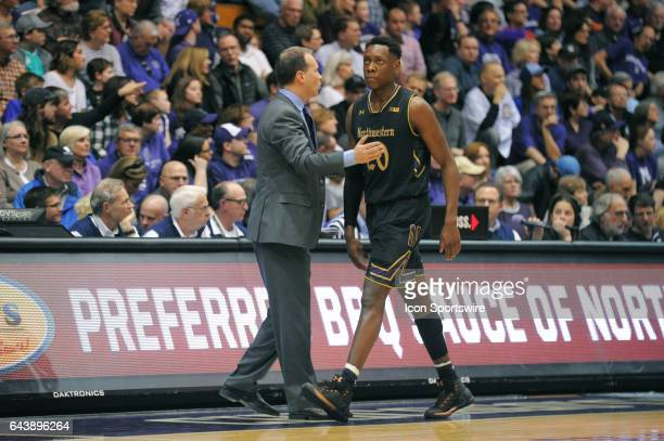 Northwestern Wildcats head coach Joe McKeown comforts Northwestern Wildcats guard Scottie Lindsey as he exits the court in the second half during a...
