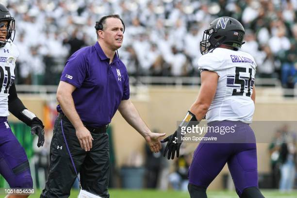 Northwestern Wildcats head coach Pat Fitzgerald congratulates Northwestern Wildcats linebacker Blake Gallagher during a Big Ten Conference college...
