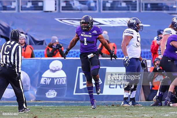 Northwestern Wildcats linebacker Anthony Walker Jr. Celebrates after making a stop on the goal line during the 2016 Pinstripe Bowl between the...