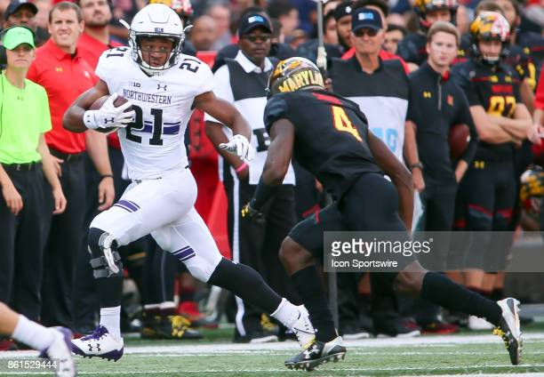 Northwestern Wildcats running back Justin Jackson races away from Maryland Terrapins defensive back Darnell Savage Jr during a college football game...