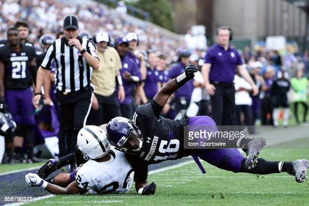 Northwestern Wildcats safety Godwin Igwebuike is called for targeting on Penn State Nittany Lions running back Miles Sanders during the game between...