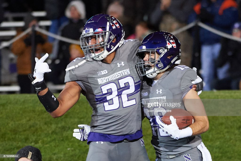 Northwestern Wildcats wide receiver Riley Lees (19) celebrates with Northwestern Wildcats linebacker Nate Hall (32) and teammates after returning the football for a touchdown during the college football game between the against the Northwestern Wildcats and the against the Purdue Boilermakers on November 11, 2017, at Ryan Field in Evanston, IL.