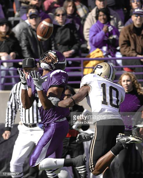 Northwestern WR Shaun Herbert watches the ball into his hands as he out races Purdue's Royce Adams in a game won by Purdue over Northwestern 31-10 at...