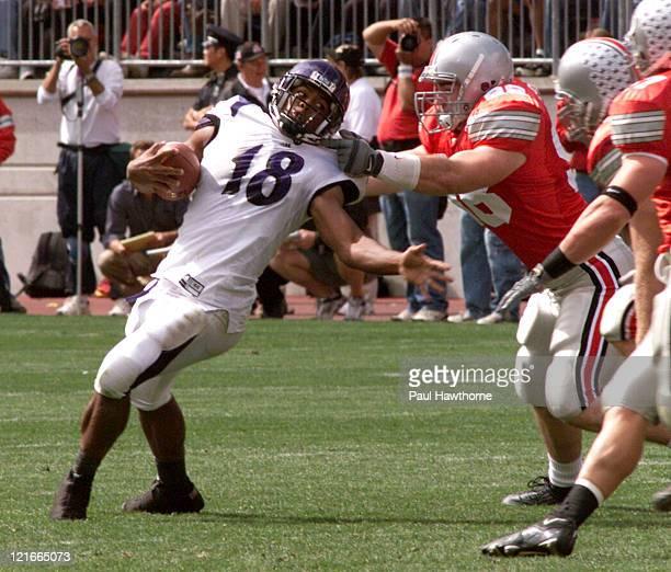 NorthwesternÆs Jason Wright tries to shake a Ohio State defender during first half action at Ohio Stadium in Columbus Ohio September 27 2003 Ohio...