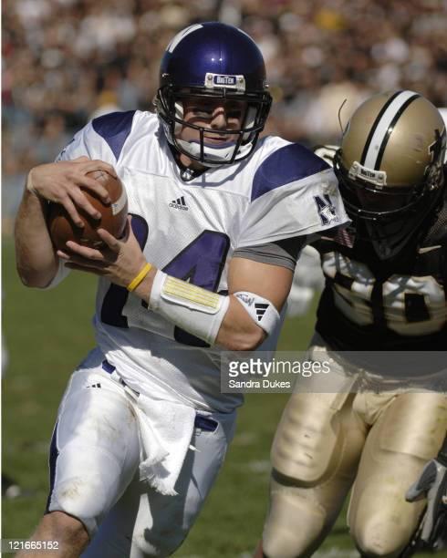 Northwestern's quarterback Brett Basanez runs past George Hall for a touchdown in Northwestern's 34-29 win over Purdue at Ross Ade Stadium in West...
