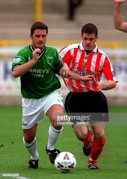 Northwich Victoria's Peter Holcroft battles with Stevenage Borough's Paul Armstrong