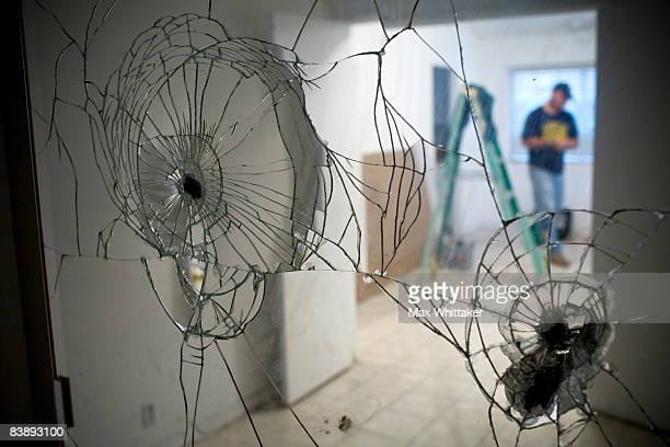 NorthWoods subcontractor Doug Joellenbeck is reflected in a vandalized mirror in a foreclosed home December 2 2008 in Sacramento California Many...