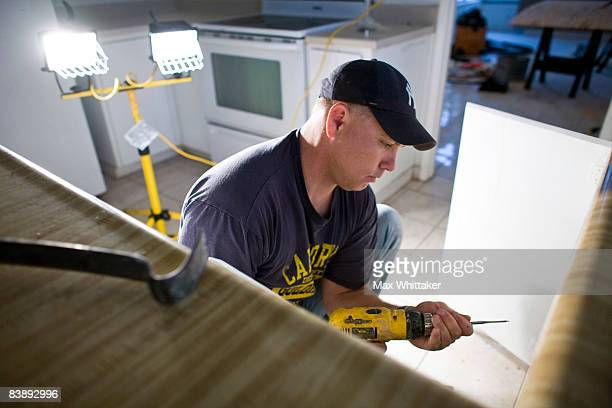 NorthWoods subcontractor Doug Joellenbeck repairs mold damage in a foreclosed home December 2 2008 in Sacramento California Many foreclosed homes...