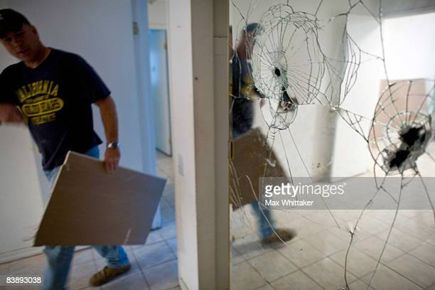 NorthWoods subcontractor Doug Joellenbeck walks past a vandalized mirror in a foreclosed home December 2 2008 in Sacramento California Many...