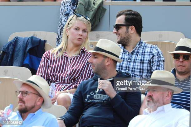Norvegian football player Ada Hegerberg and a guest attend the 2019 French Tennis Open Day Twelve at Roland Garros on June 06 2019 in Paris France