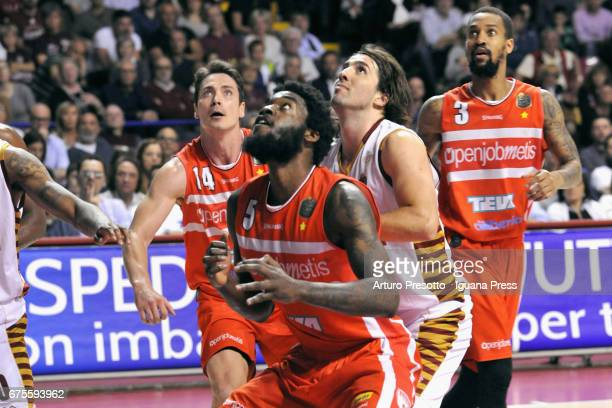 Norvel Pelle and Kristjan Kangur and Eric Maynor of Openjobmetis competes with Ariel Filloy of Umana during the LegaBasket of Serie A1 match between...