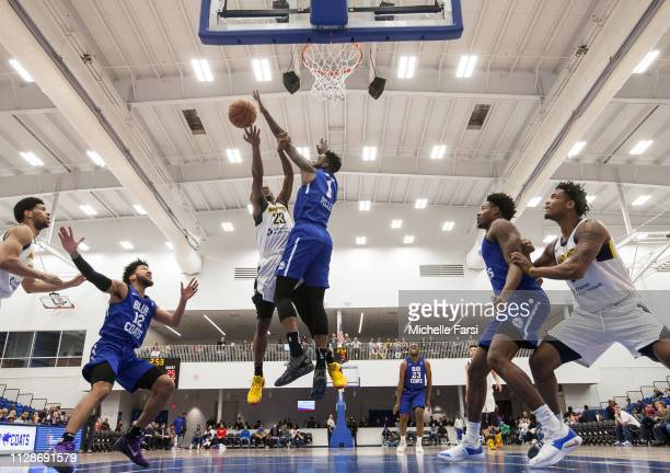 Norvel Pelle of the Delaware Blue Coats blocks shot against DemetriusDenzelDyson of the Fort Wayne Mad Ants during an NBA GLeague game on March 4...