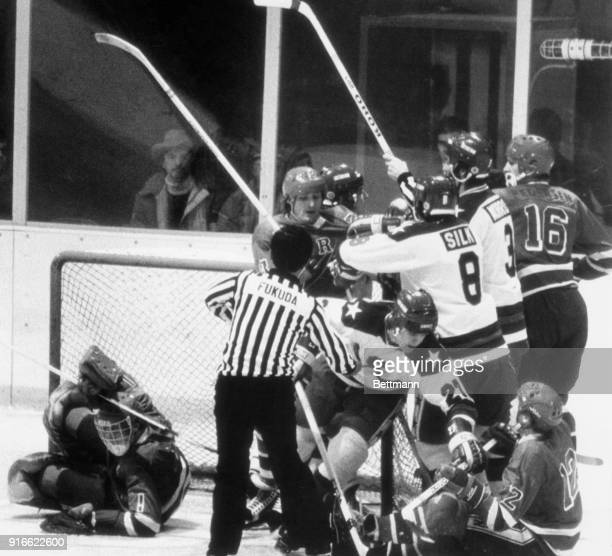 Norway and the USA mix it up in a free-for-all battle near the Norway goal. Tore Falk Nilsen pulls American Mike Eruzione off his feet, while Dave...