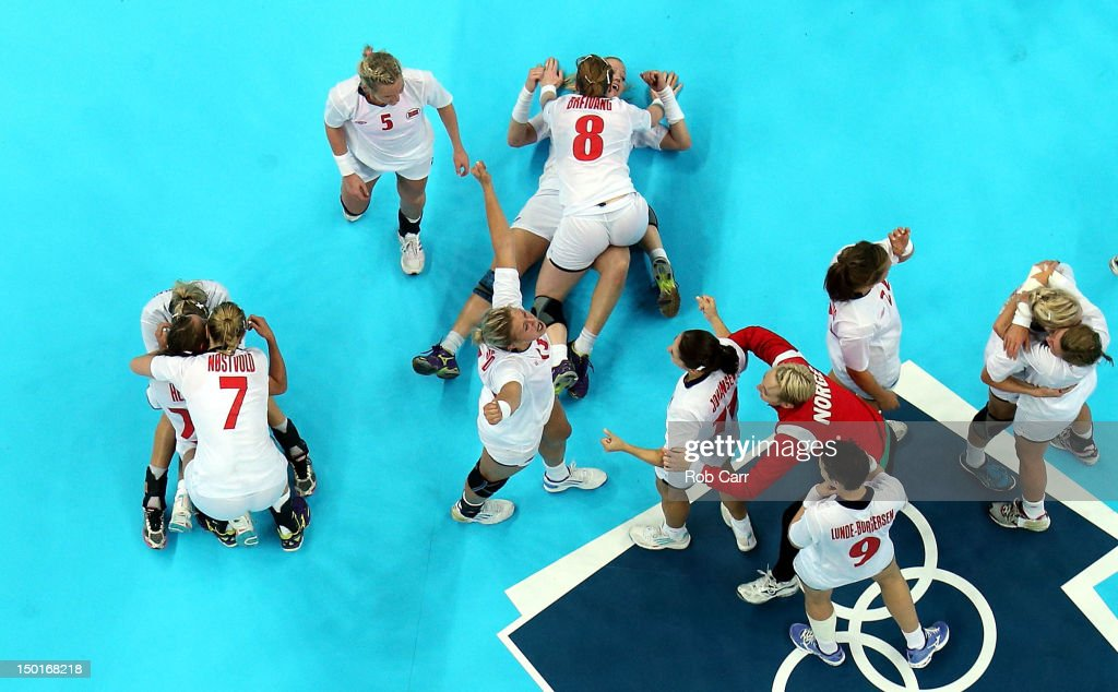 Norway celebrates winning the gold medal against Montenegro in the Women's Handball Final Match on Day 15 of the London 2012 Olympics Games at Basketball Arena on August 11, 2012 in London, England.