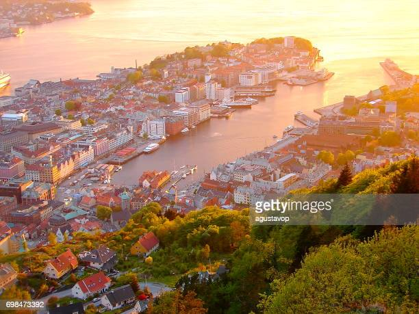 norway: impressive bergen cityscape bay at gold colored sunset from above, norwegian dramatic landscape, scandinavia – nordic countries - bergen norway stock pictures, royalty-free photos & images