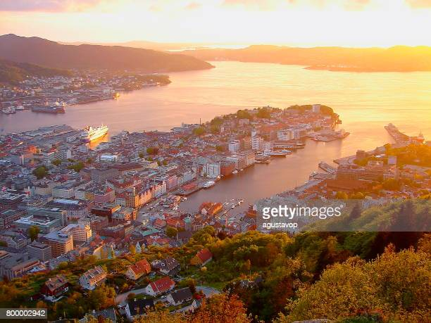 norway: impressive bergen cityscape bay at gold colored sunset from above, norwegian dramatic landscape, scandinavia – nordic countries - bay of water stock pictures, royalty-free photos & images