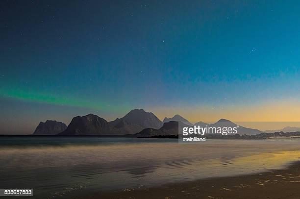 Norway, Lofoten Islands, Flakstad, Sandnes, Brewing aurora borealis