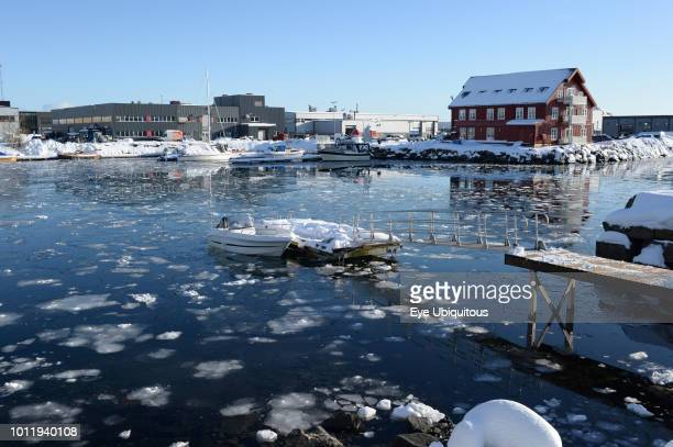 Norway Lofoten Svolvaer Partially frozen inner harbour with floating ice and leisure boats
